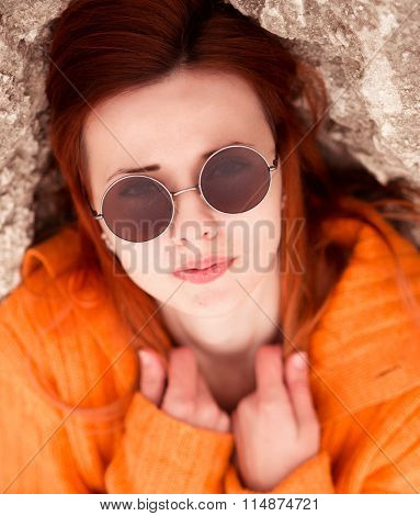 Fashionable portrait of amazing, red-haired, fashionable, cute girl, model with wear trendy, modern, round, unusual, cool, original sunglasses, pure, clean, pale, white skin, interesting eyesight, vision, brown eyes