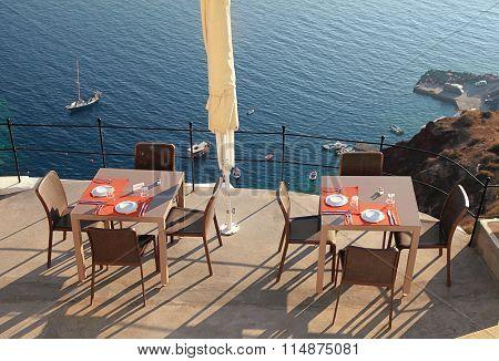 Alfresco Cafe On Terrace Over Sea Coast, Santorini, Greece