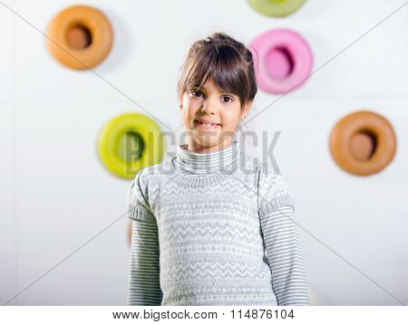 The little girl posing in a playroom
