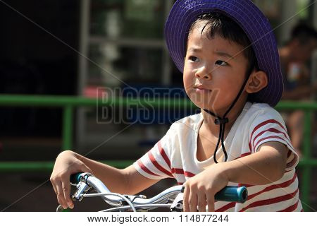 Japanese boy riding on the bicycle (4 years old)