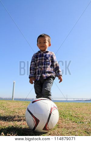 Japanese boy playing with soccer ball (3 years old)