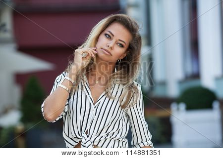 Beautiful young blond woman on a street
