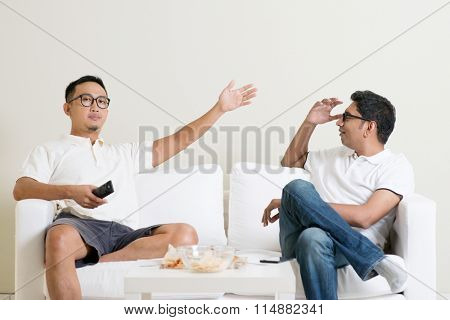 Men arguing. Two male friend having argument at home. Multiracial people friendship.
