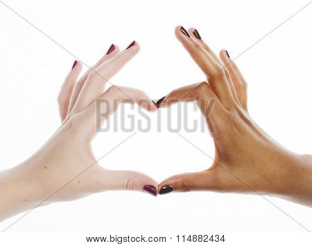two different nathion manicured hands on white isolated, african with caucasian close up