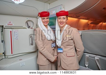 HONG KONG - DECEMBER 10, 2014: Emirates crew members on board of Airbus A380. Emirates is an airline based in Dubai, United Arab Emirates. It is the largest airline in the Middle East.