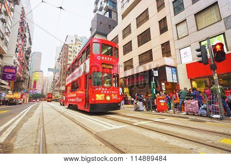 HONG KONG - FEBRUARY 20, 2015: double-decker tramway in Hong Kong. Hong Kong is an autonomous territory on the southern coast of China at the Pearl River Estuary and the South China Sea.