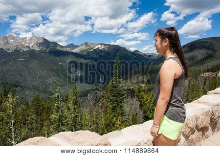 Teenage Girl Looking At The Mountains