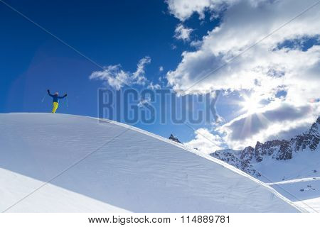 Skier during sunny day in high mountains