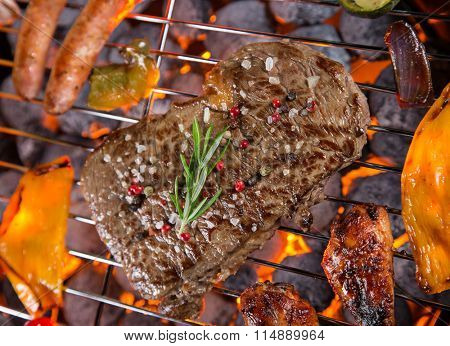 Grilled beef steaks on the grill, close-up.