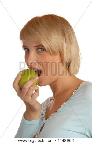 Attractive Blond Girl Eating An Apple