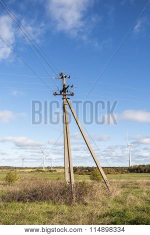 Old electric pylon in a field