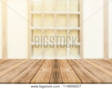 Wooden board empty table in front of blurred background. Perspective brown wood over blur in coffee shop - can be used for display or montage your products.Mock up for product. Vintage filter.