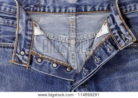 Fly Of The Blue Jeans With Button And Buttonhole