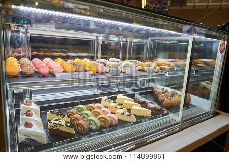 HONG KONG - SEPTEMBER 09, 2015: showcase with dessert in McCafe. McCafe is a coffee-house-style food and drink chain, owned by McDonald'sStates.