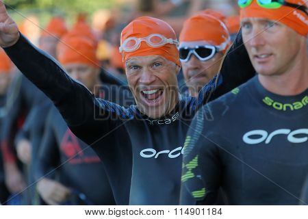 Happy Male Triathlete Smiling And Making Victory Sign