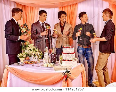 Group happy men at stage party before wedding. Only male friend.