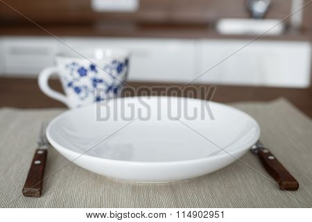 Table setting in a domestic kitchen
