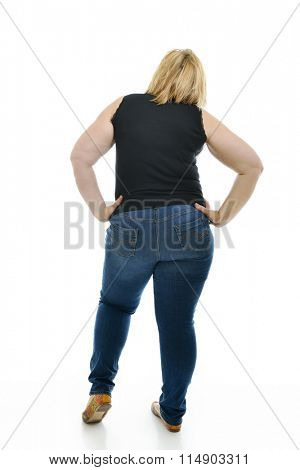 Overweight young woman, full length portrait, back view, over white background.