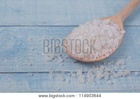 Sea Salt In Spoon On A Wooden Table