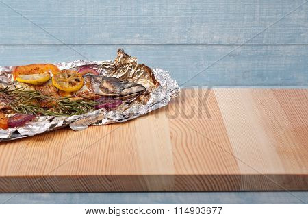 Grilled Mackerel Fish On A Kitchen Wooden Table