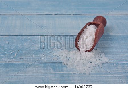 Sea Salt In Scoop On A Wooden Table