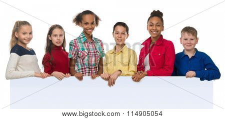children of different complexion holding an empty blank with thumbs up isolated on white background