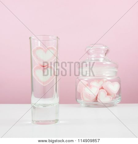 The lovely pink heart marshmallows in small narrow glass and small glass jar