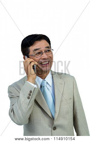 Smiling asian businessman phone calling on white background
