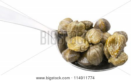 Pickled Capers In Spoon Close Up Isolated