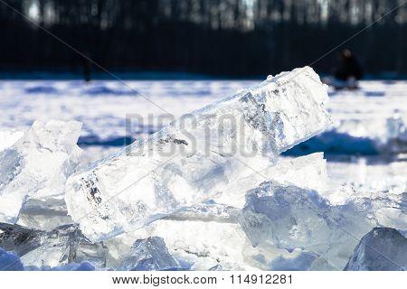 Ice Blocks Illuminated By Sun On Frozen Lake