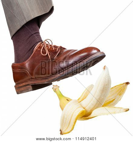 Foot In The Right Brown Shoe Slips On Banana Peel