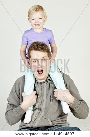 portrait of father with his little daughter