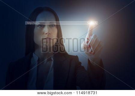 businesswoman in formal wear searching something in internet