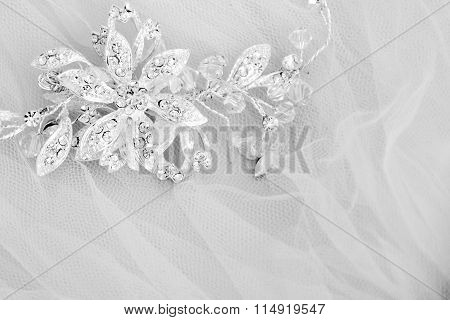 White and black wedding photo with jewelry brooch at the top