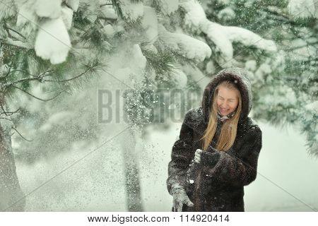 Woman In A Fur Coat In Snowy Woods