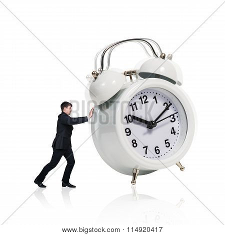 Business woman stand near big alarm clock