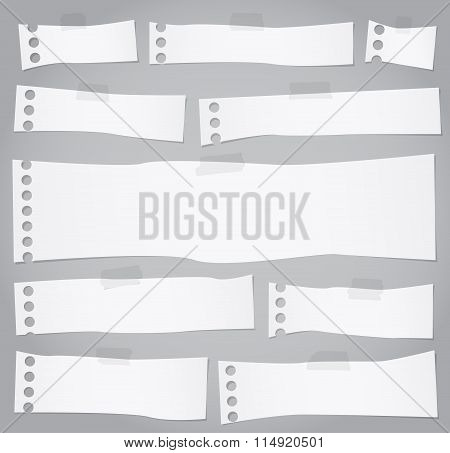 Pieces of torn white blank note paper with adhesive tape
