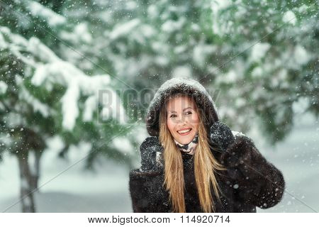 Woman In A Fur Coat In Snowy Woods