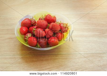 Plate With Strawberries Clouse Up On A Light Blurred Background.