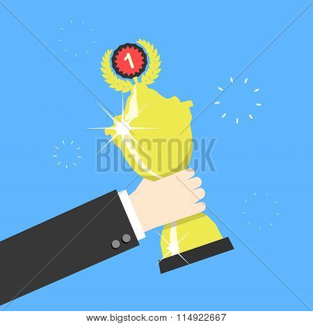 Hand Holding Winners Trophy Award. Vector Illustration