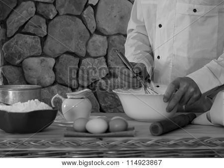 a man prepares the dough