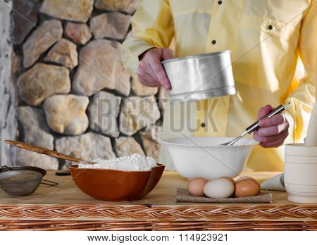 a man prepares the dough
