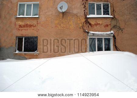 Snowbank Near The House