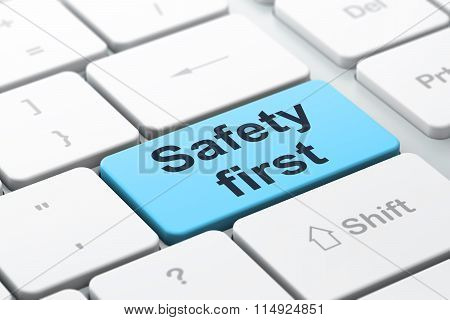 Protection concept: Safety First on computer keyboard background