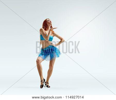 air kiss. redheaded dancing girl pose