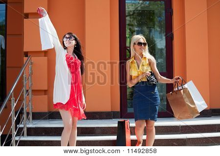 Two Young Women With Shopping Bags.