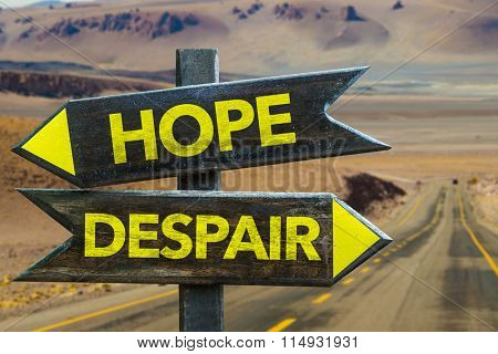 Hope - Despair signpost in a desert road on background