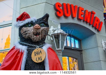 RIGA, LATVIA - DECEMBER 20, 2015: Riga Cat statue old town at evening on December 20, 2015 in Riga, Latvia