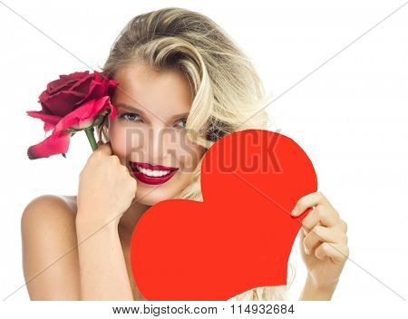 beauty portrait of attractive  caucasian smiling woman blond isolated on white studio shot red rose lips toothy smile face long hair head and shoulders looking at camera red heart valentine's love