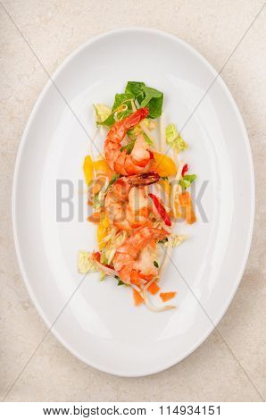 Shrimps With Salad On A White Plate